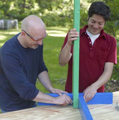 two men bolting stand together for ladder golf game set