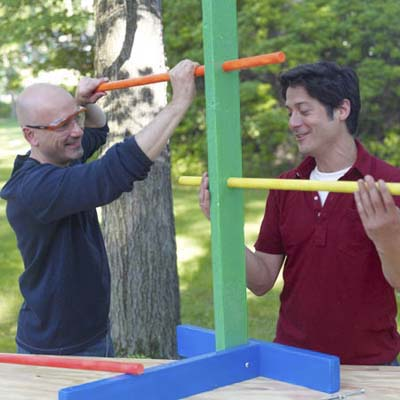 two men inserting rungs for ladder golf game set