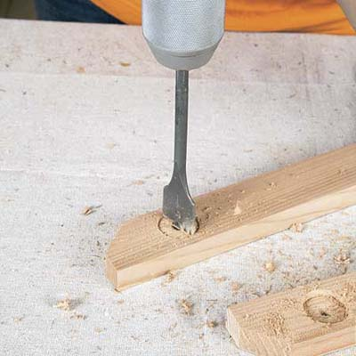 Mark Powers uses a 1-inch drill bit to make a countersink recess for the bar cart's handle