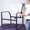 man sliding new chair sling onto chair frame