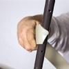 man attaching vinyl strap to outdoor patio chair frame