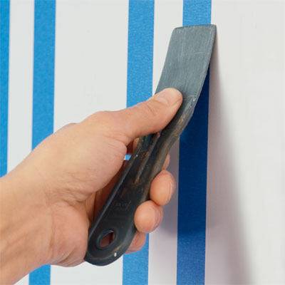 seal the tape in order to paint a striped wall