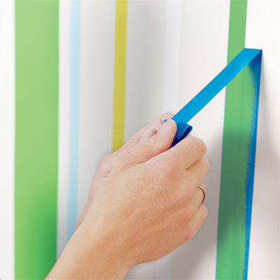 remove the tape before the the paint dries from the first round of painting a striped wall