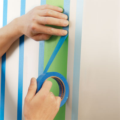 apply a second round of tape for painting a striped wall