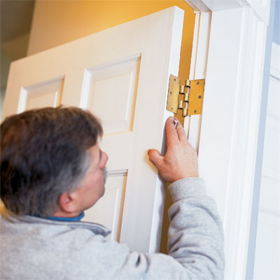 this old house general contractor tom silva re-hanging the repaired door