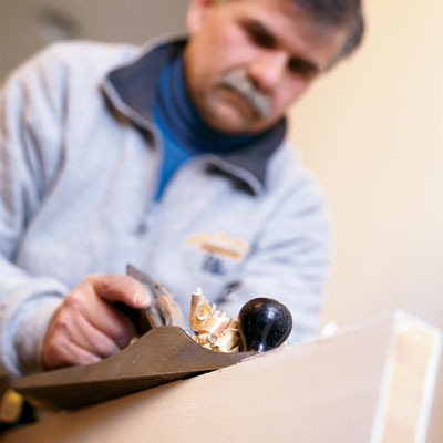 this old house general contractor tom silva shaves a door using a hand plane