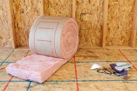 room with roll of insulation batting and tools