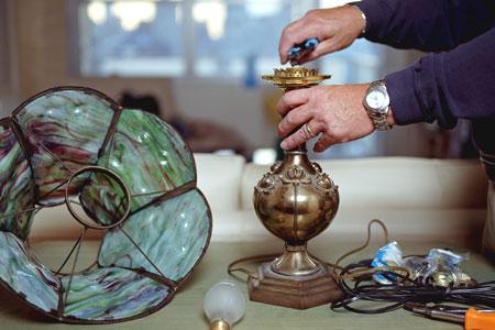 hands rewiring a lamp
