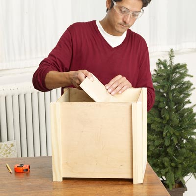 Mark Powers attaches the bottom of the x-mas tree box stand
