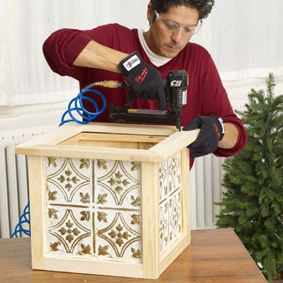 Mark Powers attaches the frame for the top of the x-mas tree box stand