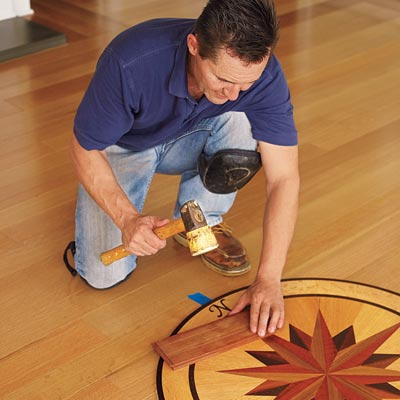tapping the medallion flush with the rest of the floor with a rubber mallet and a piece of scrap wood to prevent scratches