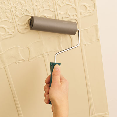 using a smoothing roller to the Lincrusta wainscot panel to minimize air bubbles