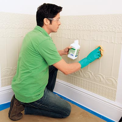 applying mineral spirits to the installed Lincrusta wainscot panels in order to clean it before painting
