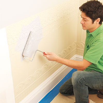 applying primer to the installed Lincrusta wainscot panels