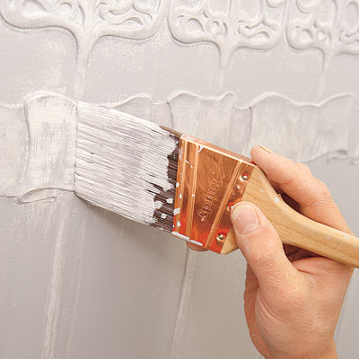 adding highlights to the painted Lincrusta wainscot panels with a dry brush