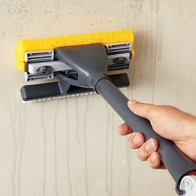 washing the wall with a sponge mop