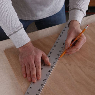 man using ruler to measure poker table