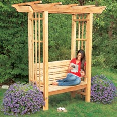 finished arbor bench with woman sitting in it