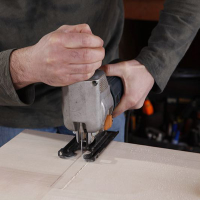 cutting notches into the wine-rack insert piece with a jigsaw
