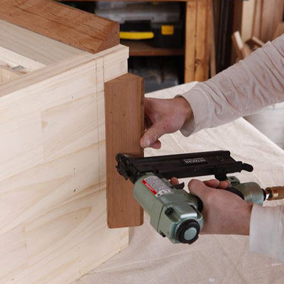 Install the baseboard molding to make a wine hutch