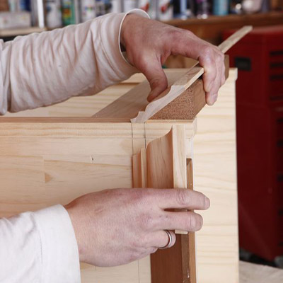 Miter-cut the crown molding to make a wine hutch