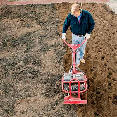 toh landscape contractor roger cook tilling the soil