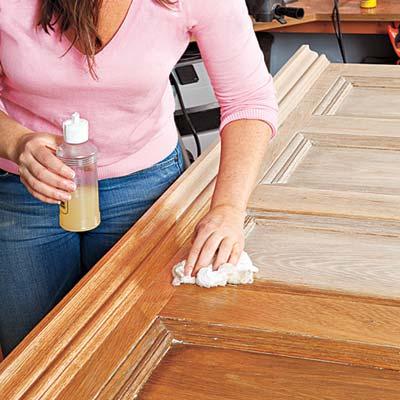 applying a furniture polish to the door/headboard