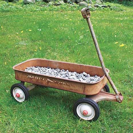 line the wagon with gravel to make a herb planter on wheels
