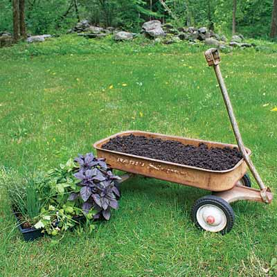 add potting soil and pant herbs to make a herb planter on wheels