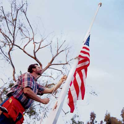 toh master carpenter Norm Abram raising a flag on the installed in-ground flagpole