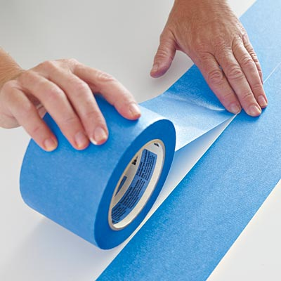 laying the second row of painter's tape on a table surface