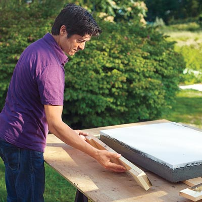 Mark Powers removes the frame for the hypertufa tabletop