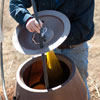 attaching the compost bag to the lid of a rain barrel