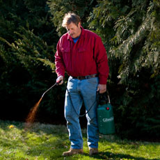 Roger Cook spraying compost tea to fertilize a lawn