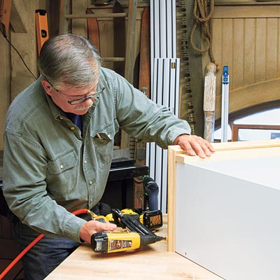 Tom Silva adds trim to the bookcase/cabinet