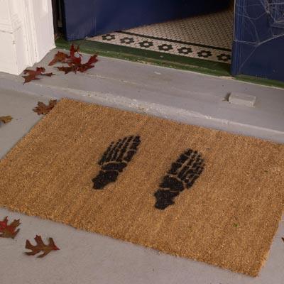 a skeleton-feet stenciled doormat
