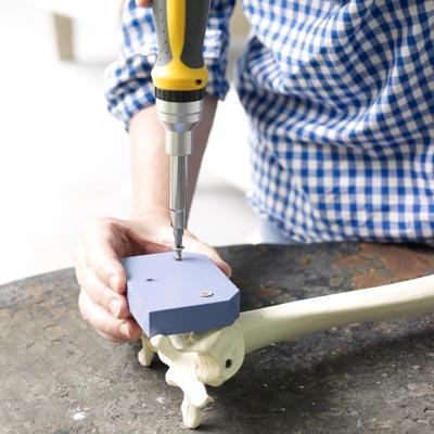 fastening the mounting block to the fake bones