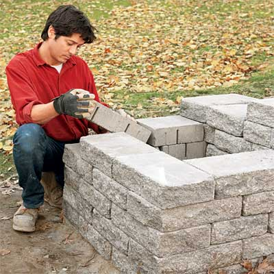 lay the final courses to build a stone planter