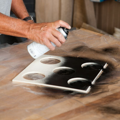 Tom Silva spray paints the bottle hole insert black