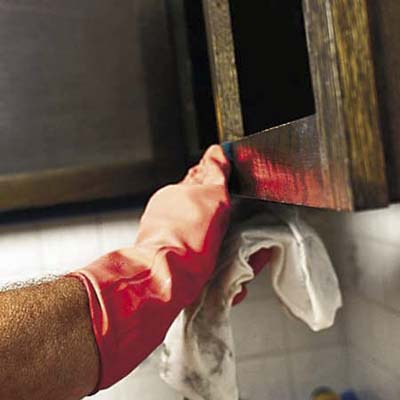 removing cabinet door with work gloves
