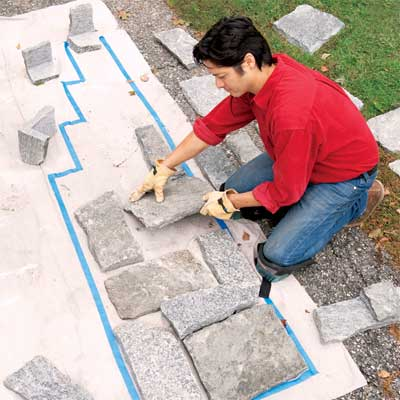 fit the stones to clad concrete steps in stone