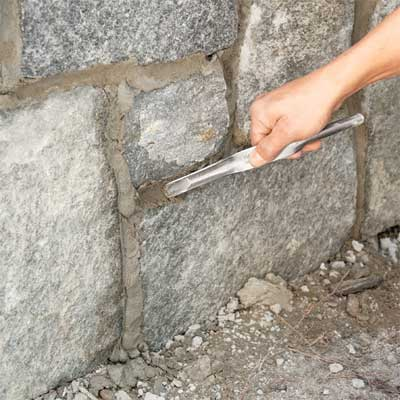 strike the grout lines to clad concrete steps in stone