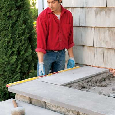 install the perimeter treads to clad concrete steps in stone