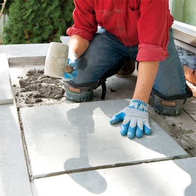 add the interior pavers to clad concrete steps in stone