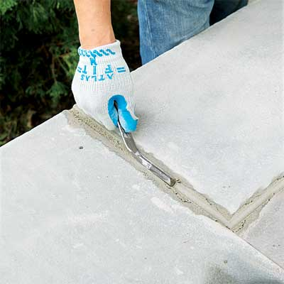 grout the joints to clad concrete steps in stone