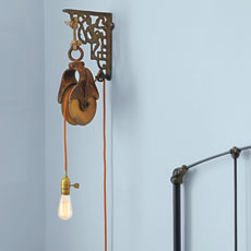 a lighting fixture that uses a barn pulley and a clothesline pulley