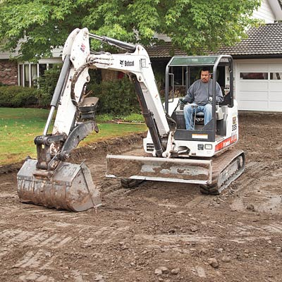 excavating a new driveway with a backhoe