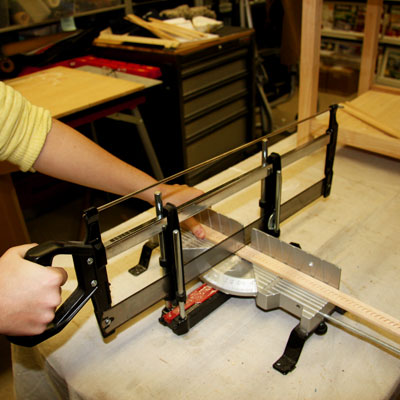cutting molding using a hand miter saw with a stop block
