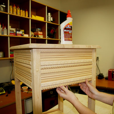 attaching the trim to the side table apron