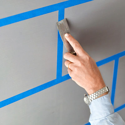 sealing the painter's tape edges with a putty knife
